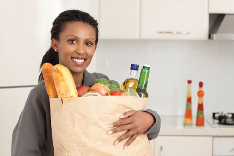 Woma with bag of groceries