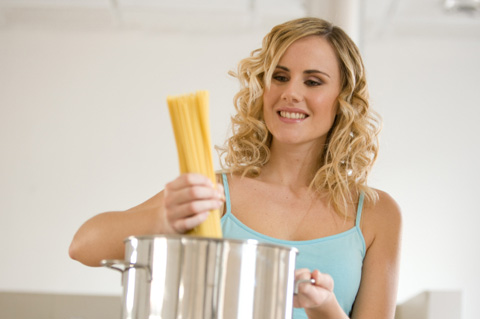 Woman cooking pasta