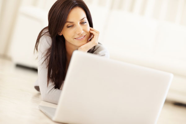 Happy woman using a laptop