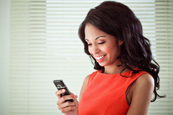 Happy woman using a smartphone