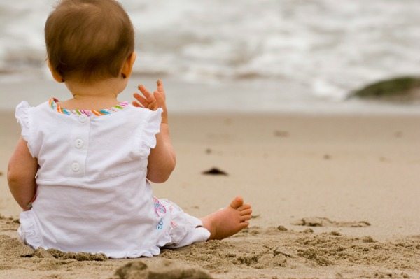 Baby facing the beach
