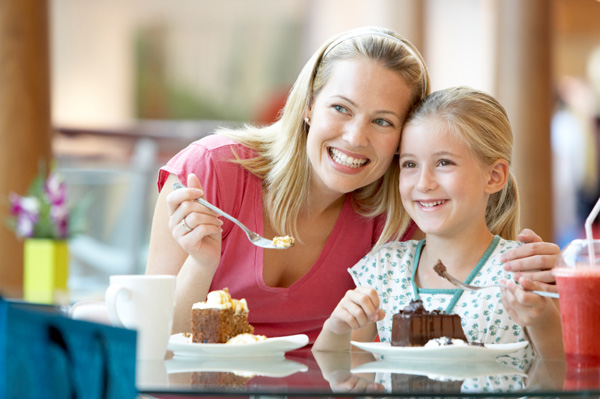 Mom having cake with daughter