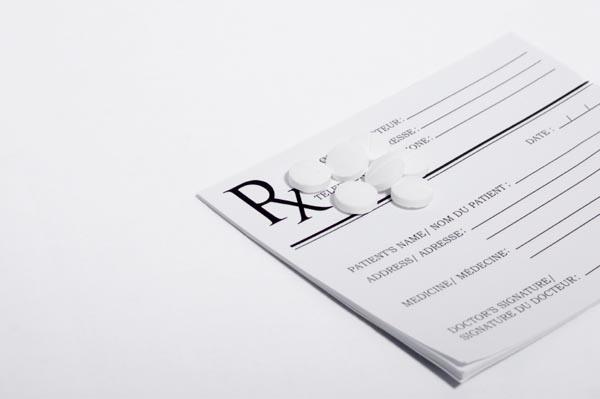 Prescription pad with white pills