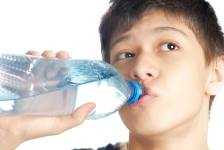 Tween drinking water