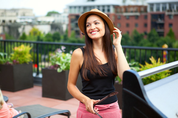 Woman bbqing on rooftop