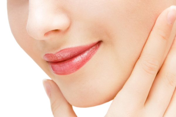 Woman touching smooth face