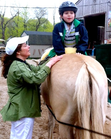 Boy on horse - Hippotherapy treatment