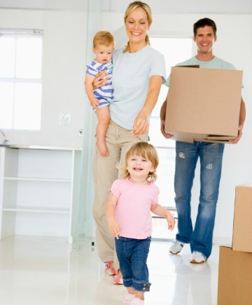 Young family with baby moving into new house