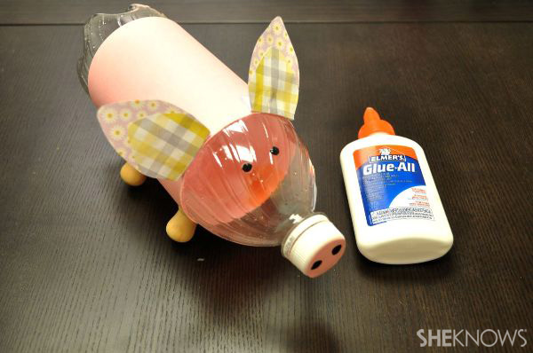 Create a piggy bank from a recycled water bottle for How to make a simple piggy bank
