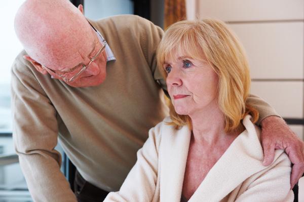 Senior man comforting woman