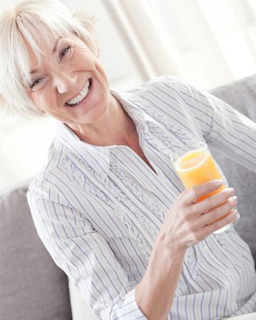 Senior woman drinking juice