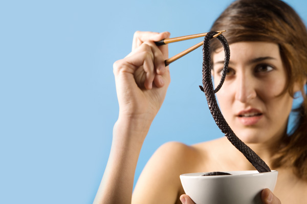 Woman eating creepy food