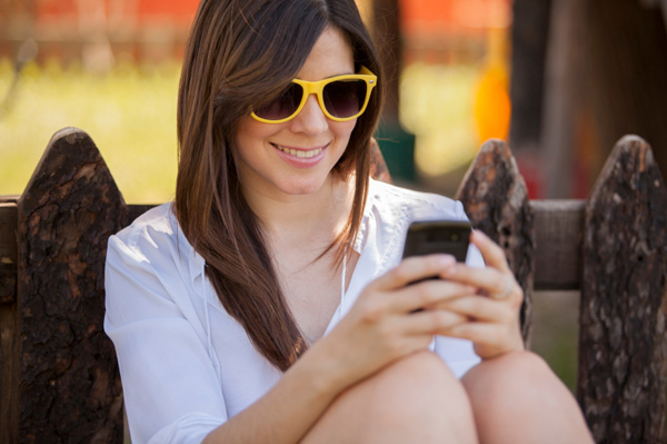 woman using smartphone on vacation