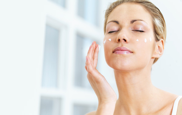 Woman applying serum