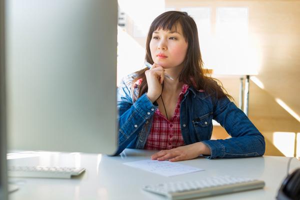 Woman thinking at work