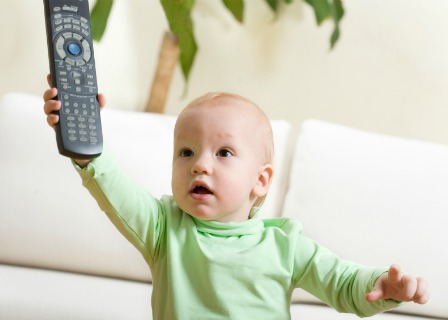 Baby with the TV remote