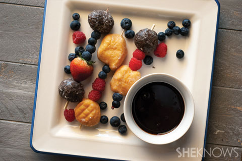 Fresh fruit and doughnut hole skewers with hot fudge dip