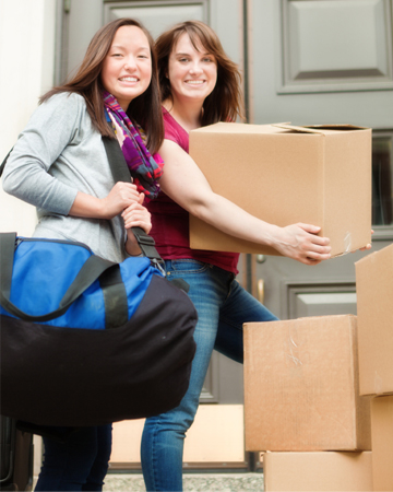 Girls moving into dorm
