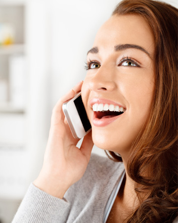 Happy woman talking to boyfriend on phone
