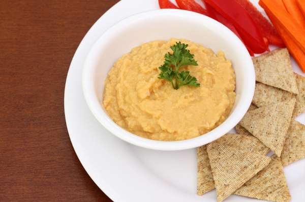 Bowl of hummus with crackers