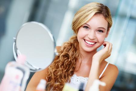 Woman applying home beauty treatments