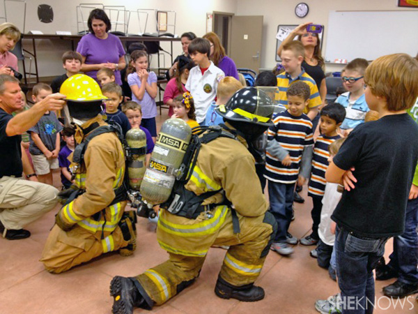 Kids with firemen learning about Labor Day