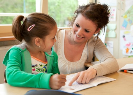 Mom teaching preschooler at home