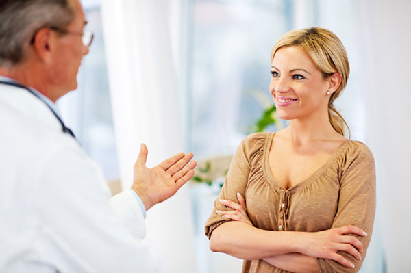 Woman talking to her OB-GYN