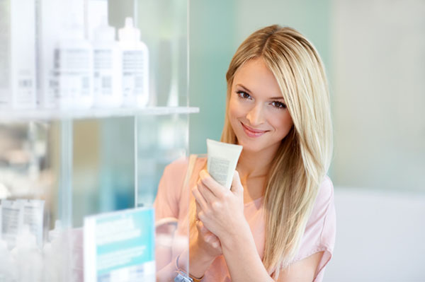 Young woman buying skin care supplies