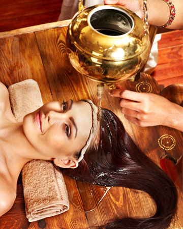 Woman getting Ayurveda treatment