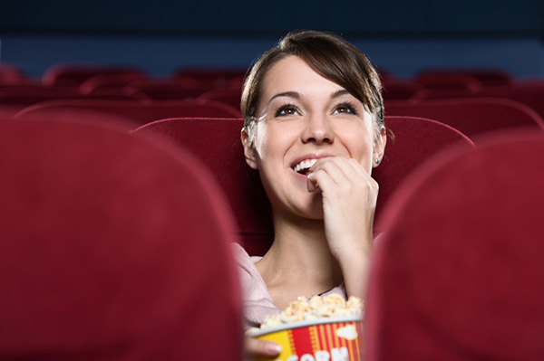 Young Woman watching movie