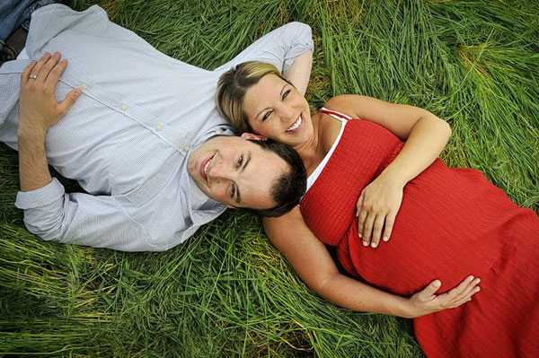 Couple laying in grass