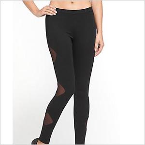 Mesh inserts on side of black leggings