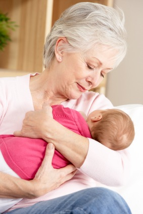 grandmother holding her grandbaby