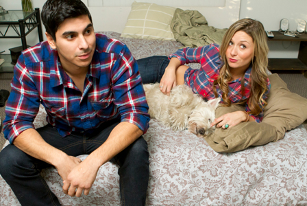 Couple in bed with dog