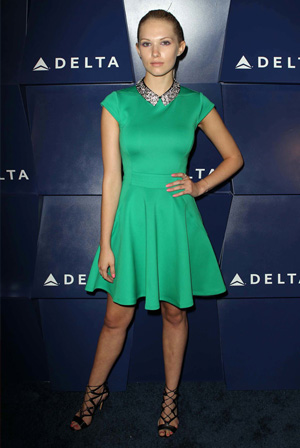 Claudia Lee wearing green dress with Peter Pan collar