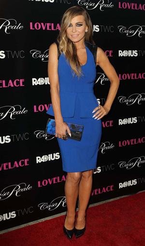 Carmen Electra wearing blue peplum dress