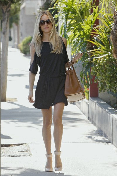 Kristin Cavallari black slit sleeve dress
