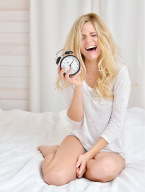 Upset woman with alarm clock