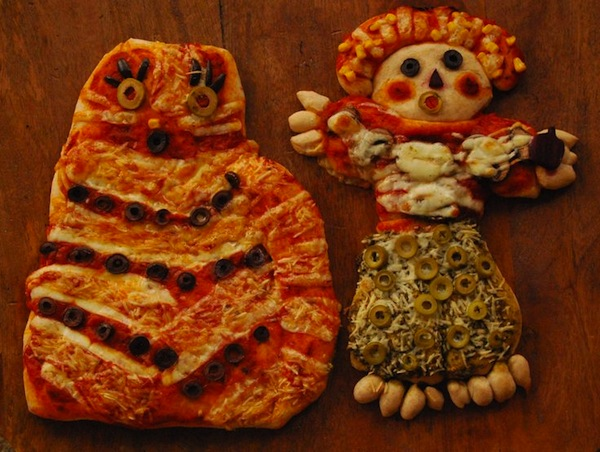 Spooky cat and scarecrow-shaped pizzas