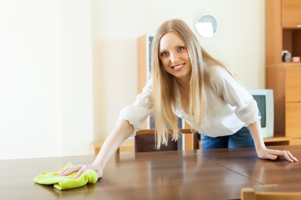 Woman cleaning woodtable