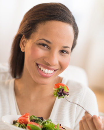 Woman eatings salad