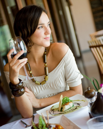 Young woman enjoying a fine dining experience