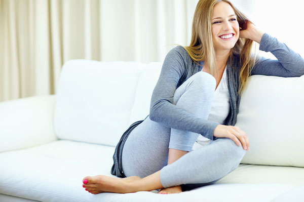 Woman relaxing on the couch | Sheknows.com