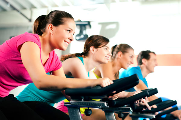 Women cycling in a class at the gym | Sheknows.ca
