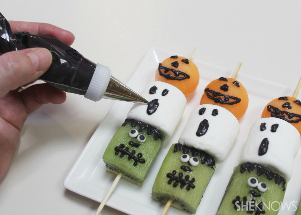 Add fun faces to fruity Halloween treats for a fun and festive bite