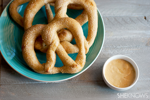 Warm cheesy beer dip with soft pretzels