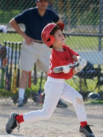 Boy hitting baseball