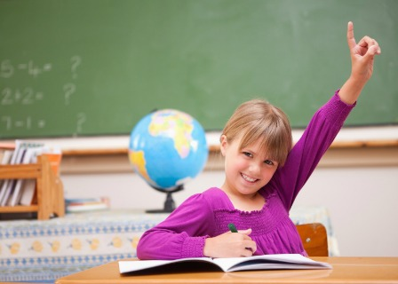 Kid raising her hand in school