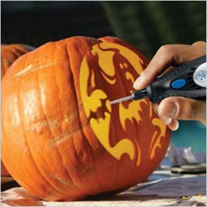 Pumpkin being carved with a dremel tool